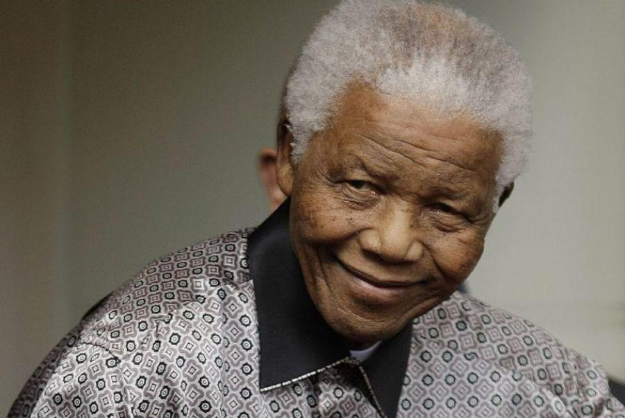 O ex-presidente sul-africano mostra a alegria de viver com duas décadas de liberdade