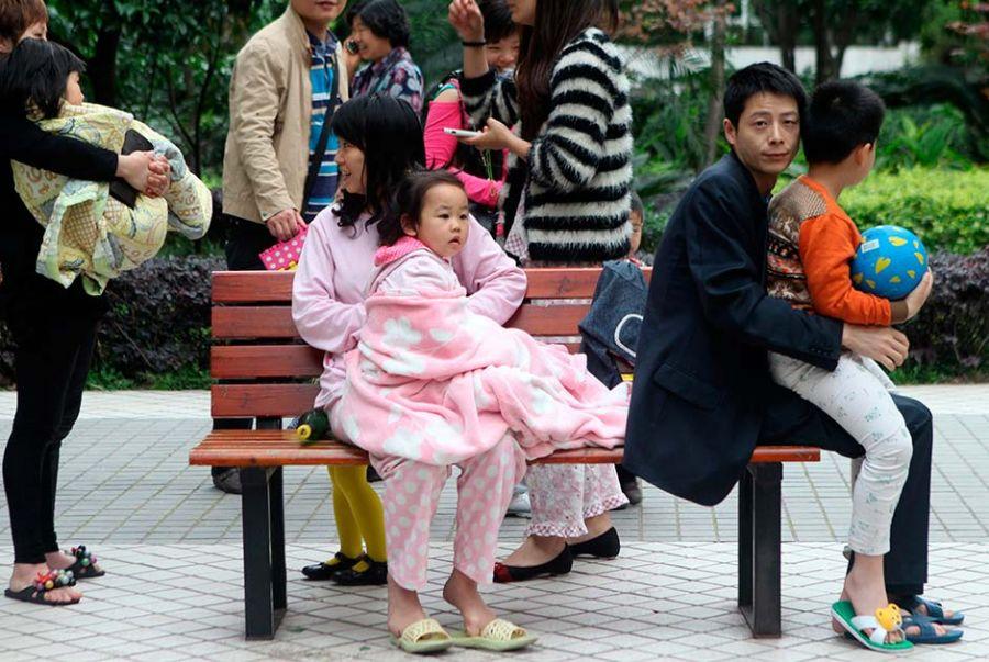 Muitos chineses tiveram que deixar suas casas de pijama