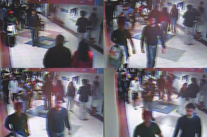 Armado, criminoso carrega compras pagas por universitário sequestrado (de mangas compridas) / Reprodução TV Band Minas