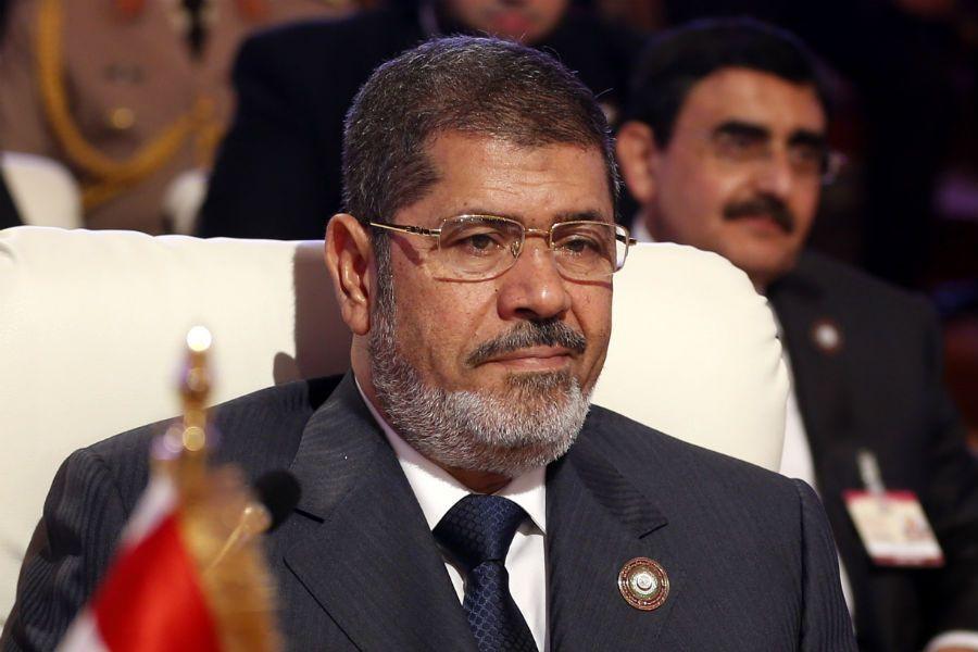 O presidente islamita deposto deverá responder pela morte de pelo menos sete manifestantes em dezembro de 2012 / Karim Sahib/AFP