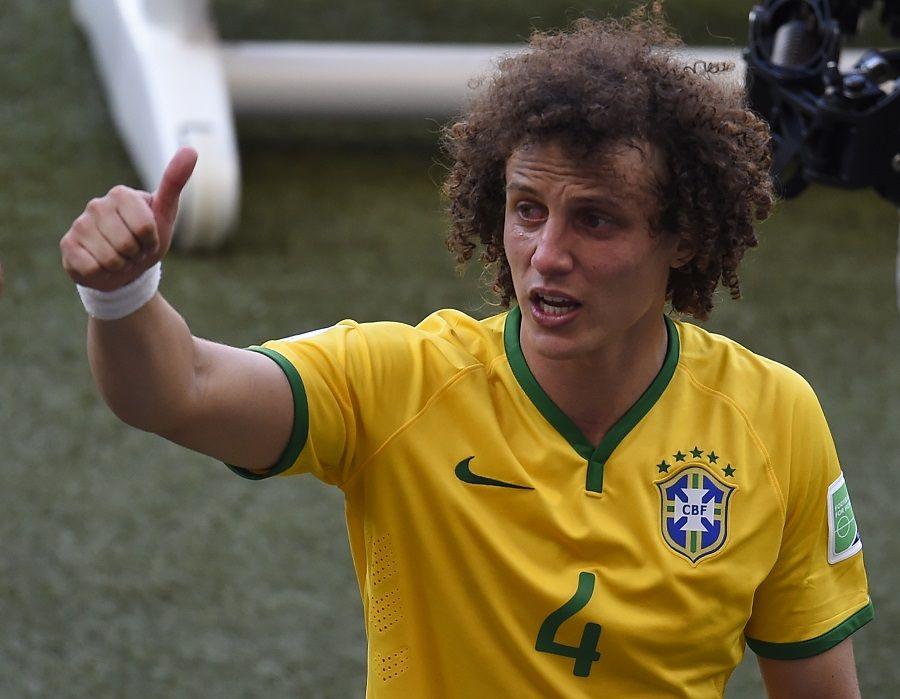 David Luiz passou James Rodríguez / Odd Andersen/AFP