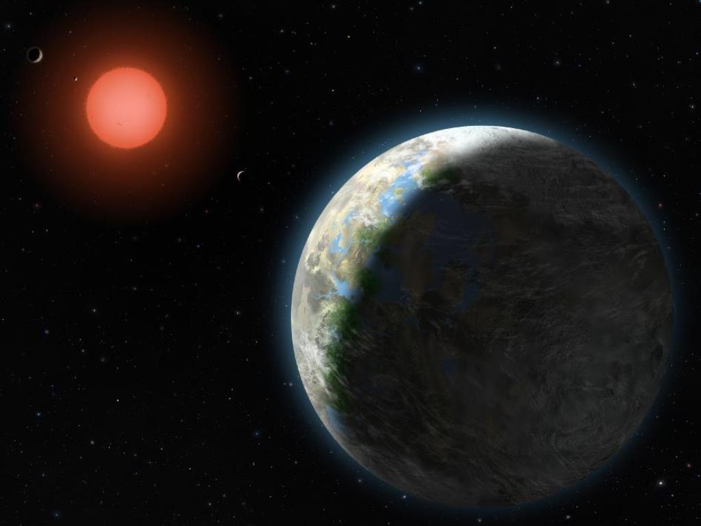 Arte conceitual divulgada pela Nasa mostrou o planeta Gliese 581g (vermelho) / Lynette Cook/NASA
