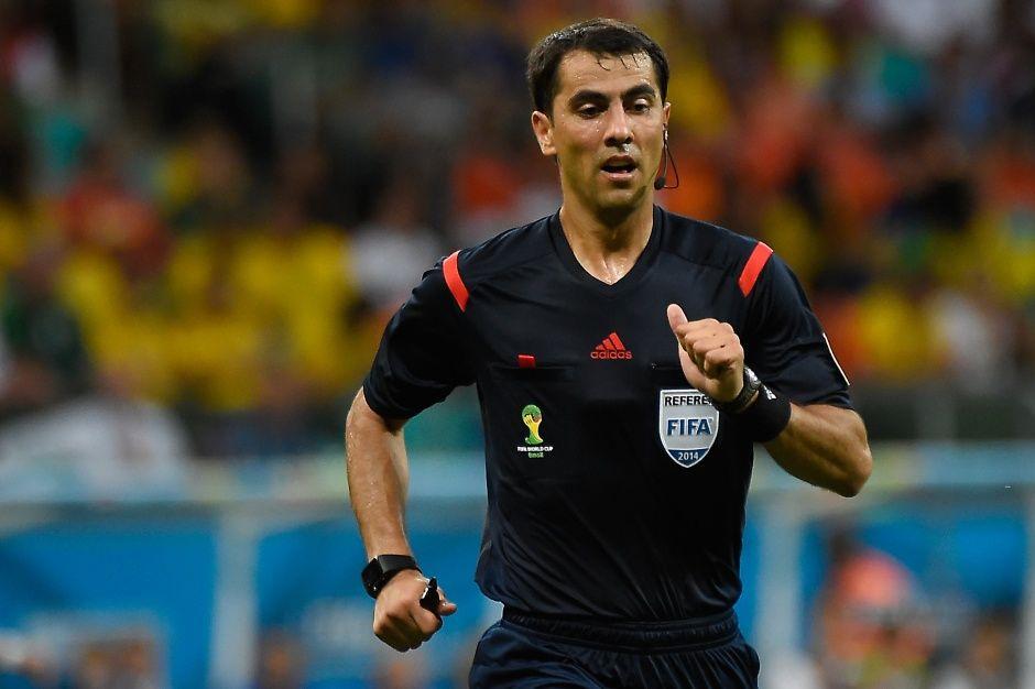 Irmatov atingiu a marca de nove partidas apitadas em Copas / Odd Andersen / AFP