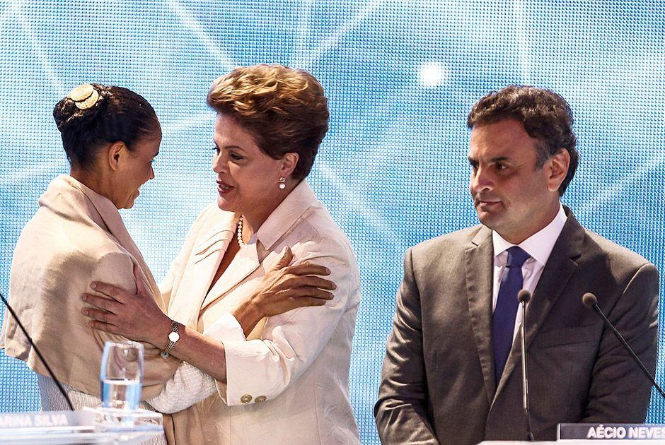 Marina, Dilma e Aécio durante debate na Band / Miguel Schincariol/AFP