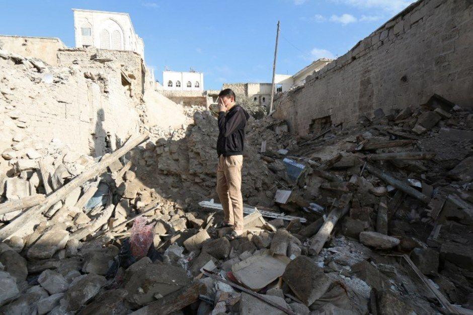 Entre os combatentes contra o regime, há 39.848 rebeldes sírios mortos e mais 34.872 jihadistas estrangeiros / Zein al-Rifai / AFP