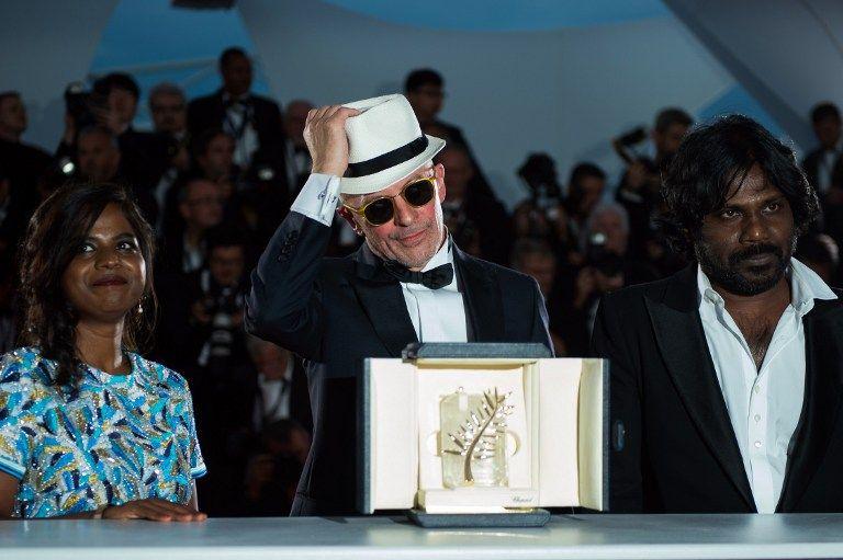 O diretor Jacques Audiard e os atores do Sri Lanka / Bertrand Langlois/AFP