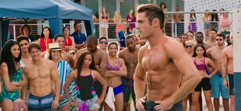Zac Efron exibe tanquinho em trailer de Baywatch
