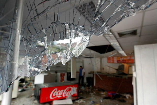 Venezuela enfrenta madrugada caótica com 11 mortes e saques