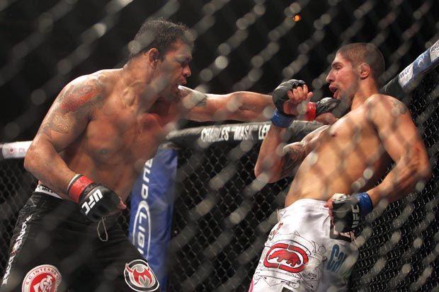Minotauro acerta soco em Schaub: vitória emocionante no UFC Rio