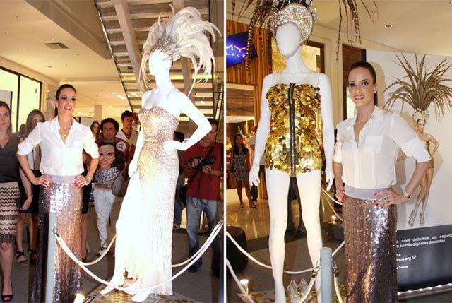 Ana Furtado posa ao lado de seus modelitos que serão leiloados