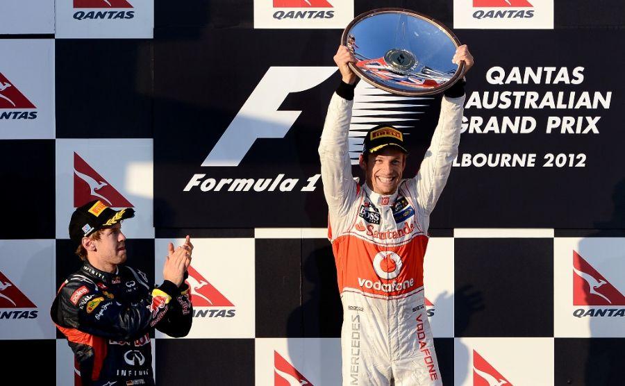 Button venceu a corrida, seguido pelo atual bicampeão Sebastian Vettel / William West/AFP