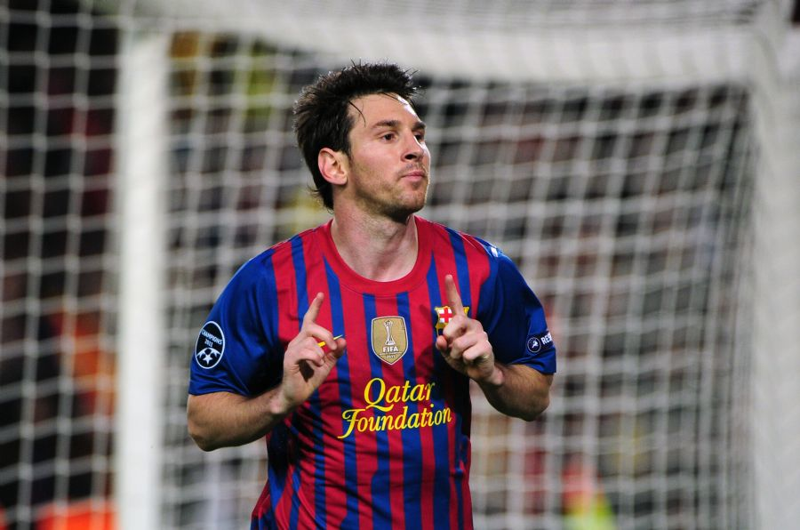 Messi faz dois gols na vitória do Barcelona sobre o Milan nesta quarta-feira / Olivier Morin/AFP
